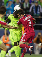 Seattle Sounders FC defender Jhon Kennedy Hurtado and Chicago Fire defender head the bacll during play between the Seattle Sounders FC and the Chicago Fire in the U.S. Open Cup Final at CenturyLink Field in Seattle Tuesday October 4, 2011. Seattle won the game 2-0 to win its third U.S. Open Cup.