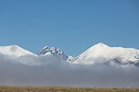 Crestones with fog bank from Highway 69 south of Westcliffe
