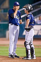 August 7,2010 Matt Peterson (35) and catcher Brad Davis (8) have a meeting during the MiLB game between the New Orleans Zephyrs and the Colorado Springs Sky Sox at Security Service Field in Colorado Springs Colorado.