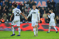 Kyle Naughton celebrates with Connor Roberts of Swansea City at full time during the Sky Bet Championship match between Swansea City and Sheffield United at the Liberty Stadium in Swansea, Wales, UK. Saturday 19 January 2019