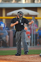 Umpire Mike Savakinas makes a call during a game between the Lakeland Flying Tigers and Tampa Yankees on April 7, 2016 at Henley Field in Lakeland, Florida.  Tampa defeated Lakeland 9-2.  (Mike Janes/Four Seam Images)