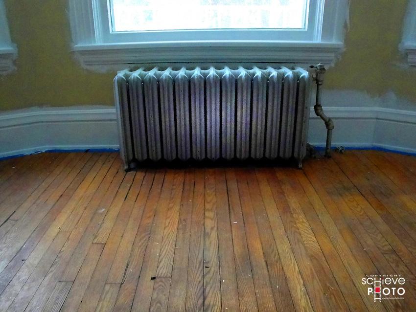 Radiator in an empty bedroom.