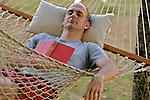 Mid adult man sleeping in hammock
