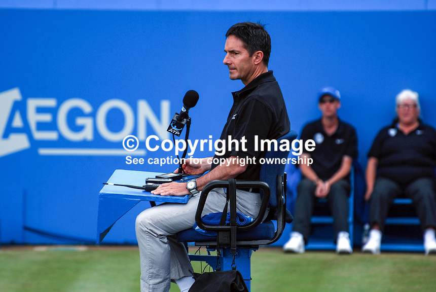 Steve Ullrich, umpiring at Queen's Club, London, UK. Steve is one of a panel of permanently employed ATP referees. 201006134294..Copyright Image from Victor Patterson, 54 Dorchester Park, Belfast, UK, BT9 6RJ..Tel: +44 28 9066 1296.Mob: +44 7802 353836.Voicemail +44 20 8816 7153.Skype: victorpattersonbelfast.Email: victorpatterson@mac.com.Email: victorpatterson@ireland.com (back-up)..IMPORTANT: If you wish to use this image or any other of my images please go to www.victorpatterson.com and click on the Terms & Conditions. Then contact me by email or phone with the reference number(s) of the image(s) concerned.