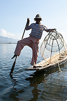 The traditional method of fishing by the Intha people of inle Lake, Myanmar, leaves both the fisherman's hands free to manoeuvre the large net-cage into the shallow water because he is able to stand on one leg and use the other, wrapped around the paddle, to drive the light, flat-bottomed boat through the water.