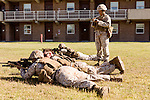 October 22, 2014. Camp LeJeune, North Carolina.<br />  Sgt. Nyree Wilson, age 27, takes notes during patrol training for the 3rd Platoon of the Ground Combat Element Integrated Task Force. Marines in 3rd Platoon of the GCEITF are all considered provisional infantrymen as they have not been to the School of Infantry (SOI) previous to volunteering for the GCEITF.<br />  The Ground Combat Element Integrated Task Force is a battalion level unit created in an effort to assess Marines in a series of physical and medical tests to establish baseline standards as the Corps analyze the best way to possibly integrate female Marines into combat arms occupational specialities, such as infantry personnel, for which they were previously not eligible. The unit will be comprised of approx. 650 Marines in total, with about 400 of those being volunteers, both male and female. <br />  Jeremy M. Lange for the Wall Street Journal<br /> COED