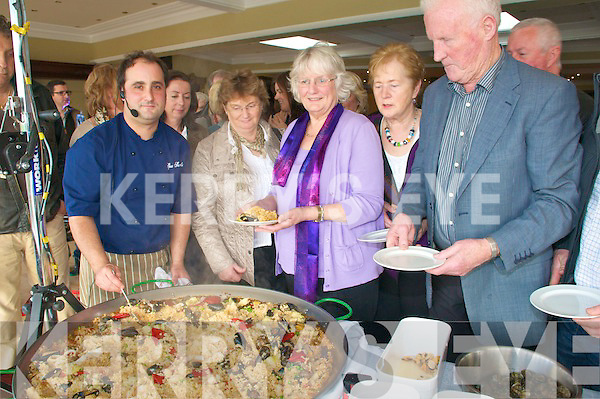 Paella Lunch : Gurka Arietta, of Spa Sea Foods, demonstrating the spectacular art of paella making at the Listowel Arms Hotel on saturday during the Listowel Food Fair. L- R Gurka Arietta, Eileen Stacj, Betty O'Connor, Lily Barrett & Mick Barrett.