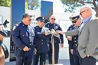 Officers from the New York Port Authority, (left to right) Vincent Zappulla, Jr, Frank Accardi, Huntington Police Officer, Corwin Bales, New York Port Authority Officer, Kevin Devlin and Robert Egbert surround the unveiled 9/11 Memorial at Huntington Beach City Hall before the ceremony on Sunday afternoon.<br /> <br /> ///ADDITIONAL INFORMATION: hb.0915.memorial &ndash; 9/11/16 &ndash; MICHAEL KITADA, ORANGE COUNTY REGISTER - _DSC8496.jpg - <br /> Summary: The Huntington Beach Police Officers' Foundation's 9-11 Memorial Committee unveils a $200,000 monument including steel from the toppled World Trade Center, at City Hall. The event will include music, a flyover, New York police and others with connections to the 9-11 rescue and victims of the tragedy.
