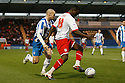 Don Cowan of Stevenage takes on Michael Rose of Colchester. - Colchester United v Stevenage - Weston Homes Community Stadium, Colchester - 26th December 2011  .© Kevin Coleman 2011