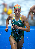 12 JUL 2014 - HAMBURG, GER - Emma Jackson (AUS) from Australia heads for transition at the end of the swim at the elite women's 2014 ITU World Triathlon Series round  in the Altstadt Quarter in Hamburg, Germany (PHOTO COPYRIGHT © 2014 NIGEL FARROW, ALL RIGHTS RESERVED)