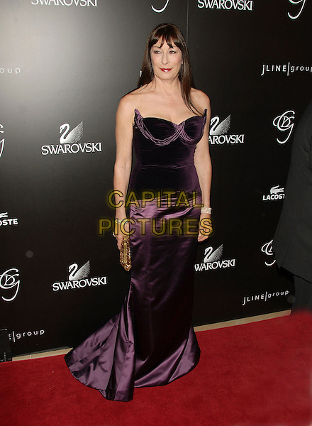 ANJELICA HUSTON.The 8th Annual Costume Designers Guild Awards Gala held at The Beverly Hilton Hotel in Beverly Hills, California, USA, February 25th 2006.    .full length    strapless purple dress                            .Ref: DVS.www.capitalpictures.com.sales@capitalpictures.com.©Debbie Van Story/Capital Pictures
