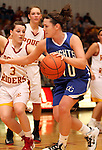 SIOUX FALLS, SD - FEBRUARY 28:  Dalee Stene #10 from O'Gorman drives against Nicole Hatcher #3 from Roosevelt in the second half of their District 1AA Championship Game Thursday night at Roosevelt. (Photo by Dave Eggen/Inertia)