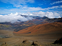 Sliding Sands Trail, cinder cones and clouds in Haleakala Crater, Haleakala National Park, Maui.