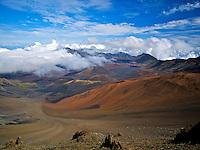 Sliding Sands Trail, cinder cones and clouds in Haleakala Crater, Haleakala National Park, Maui.