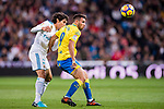 Jonathan Calleri of UD Las Palmas (R) fights for the ball with Jesus Vallejo Lazaro of Real Madrid (L) during the La Liga 2017-18 match between Real Madrid and UD Las Palmas at Estadio Santiago Bernabeu on November 05 2017 in Madrid, Spain. Photo by Diego Gonzalez / Power Sport Images