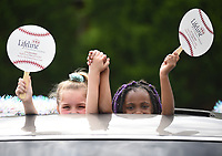 London Hines (left) and Kenisyn Jackson, both 8, wave signs Thursday, May 14, 2020, from the sunroof of a car to show support to our area seniors for Older Americans Month at the University of Arkansas for Medical Sciences Schmieding Center for Senior Health and Education parking lot in Springdale. People were encouraged to visit the parking lot at the center with decorated vehicles and make noise in an effort to show older adults that Northwest Arkansas cares. Check out nwaonline.com/200515Daily/ and nwadg.com/photos for a photo gallery.<br /> (NWA Democrat-Gazette/David Gottschalk)