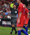 Referee Ricardo Montero of Costa Rica signals to a linesman during an international friendly game between Uruguay and the USA on September 10, 2019 at Busch Stadium in St. Louis, Missouri USA<br /> AFP Photo by Tim VIZER