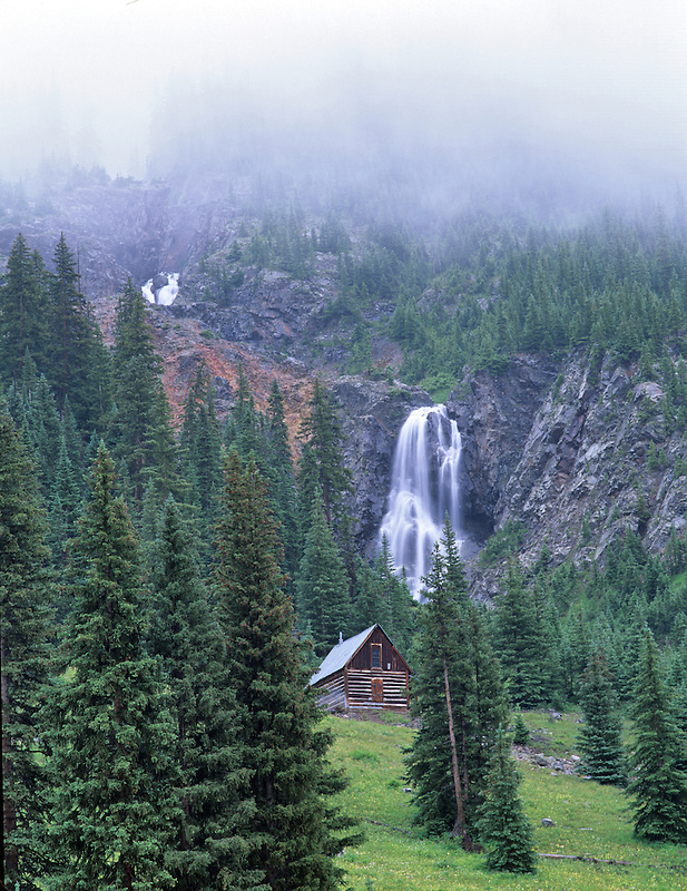 Cabin and waterfall off old mining road near Silverton, Colorado.