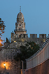 The city wall of Jerusalem with the bell tower of the Dormition Abbey outside the wall.  The Old City of Jerusalem and its Walls is a UNESCO World Heritage Site.