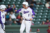 Second baseman Banks Griffith (1) of the Furman Paladins shouts as he crosses home plate with the team's first run in a game against the South Carolina Gamecocks on Tuesday, March 19, 2019, at Fluor Field at the West End in Greenville, South Carolina. South Carolina won, 12-7. (Tom Priddy/Four Seam Images)