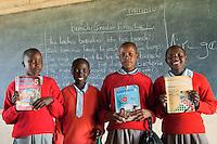 Masai children showing off their school books