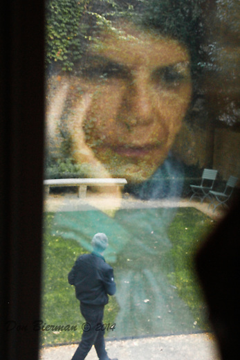 Nancy reflectedd in window of studio at Musee Delacriox.