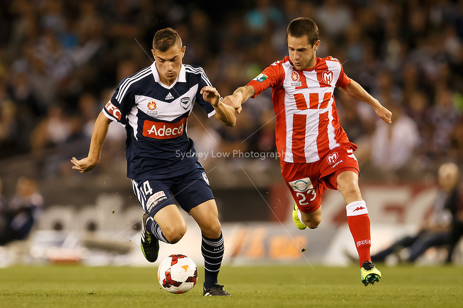 James TROISI of the Victory and Mate DUGANDZIC of the Heart fight for the ball in the round one match between Melbourne Victory and Melbourne Heart in the Australian Hyundai A-League 2013-24 season at Etihad Stadium, Melbourne, Australia.<br /> This image is not for sale. Please visit zumapress.com for image licensing.