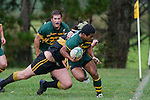 M. Tokalau tries to avoid being pushed over the sideline as he is tackled by T. Gallagher. Counties Manukau Premier club rugby game between Bombay & Pukekohe played at Bombay on the 19th of May 2007. Pukekohe led 24 - 0 at halftime & went on to win 30 - 22.