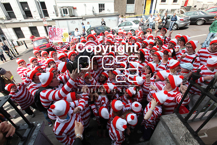 Free Pics     With Compliments<br /> Cork City was awash with Wallys on Sunday, 4th June 2011 as a striped and spectacled Where&Otilde;s Wally troop from Cork marched up Patrick&Otilde;s Hill with Jack Wise Street Performance World Champion 2010 to launch the Street Performance World Championship event, which takes place in Fitzgerald Park, Cork City on June 11th and 12th. The Wallys were on hand to sit, stand, salute, sing and do a little dance, not only to remind people what a full on fun day out for all the family the SPWC will be but also to launch the Where&Otilde;s Wally World Record attempt, which takes place in Cork on Sunday, 12th June as part of the event&Otilde;s thrill packed programme. People who wish to participate in the Where&Otilde;s Wally World Record attempt in Cork can buy their costume on www.spwc.ie for &Ucirc;12. Profits from the sales of the Wally costumes go to Africa Aware.<br /> Pic. Brian Arthur/ Press 22.