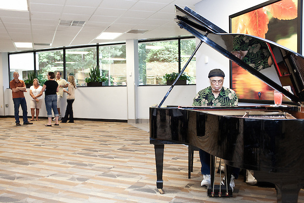 July 29, 2011. Cary, NC.. Elmer Gibson plays piano at lunch in one of the SAS campus cafeterias 3 days a week. Meals are relatively cheap and an emphasis is put on healthy food for employees.. Profile of SAS, a software company that has many amenities for its employees.