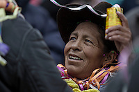 A picture dated Saturday January 26, 2013 shows a Quechua woman greeting a miner at the Miners Carnival in the Andes city of Potosi in Bolivia.  Already in 1663 the Spanish chronicler Marquez Jerez de los Caballeros described the colorful  miners carnival in Potosi. Four centuries later, the tradition of the legendary Cerro Rico miners is  still alive ..