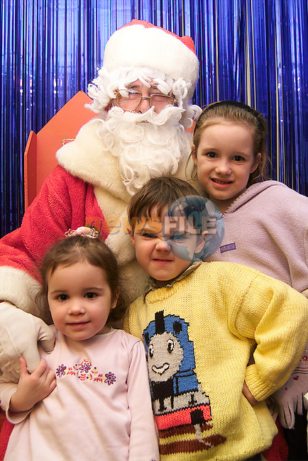 Shauna and Ciara McGrogan from Ballsgrove with Jack Gorman from Ballsgrove at Santa's Grotto in the Town Centre..Picture: Paul Mohan/Newsfile