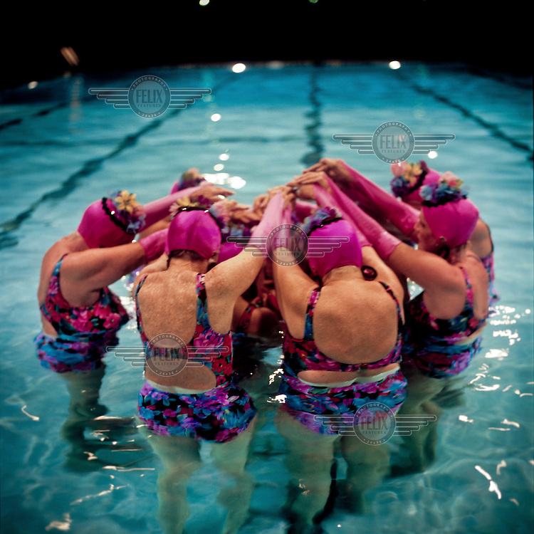 The Aquadettes practice during a dress rehearsal for a performance at Laguna Woods, California. The Aquadettes are a group of women ageing from their early 60s upwards who meet to practice synchronised swimming. Every year, they practice together, they make costumes together, they swim together, and at the end, they perform together.