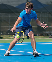 STAFF PHOTO ANTHONY REYES &bull; @NWATONYR<br /> Hayden Pennington, of Springdale Har-Ber, returns a volley duing the 7A-West Conference boys tennis tournament Wednesday, Oct. 8, 2014 at the Springdale Har-Ber tennis courts.