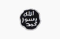 A badge for sewing onto clothing shows the seal of the prophet, the iconography used by the Islamic State Group, is one of a number of items of clothing and objects found in an Islamic clothing and accessory shop in the Bagicilar district of Istanbul.