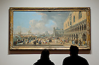 Kathy, left, and Jeremy, right, sit down to examine 'The Doge's Palace and the Grand Canal' by Luca Carlevariis during SAM Remix on Saturday, Nov. 13, 2010.