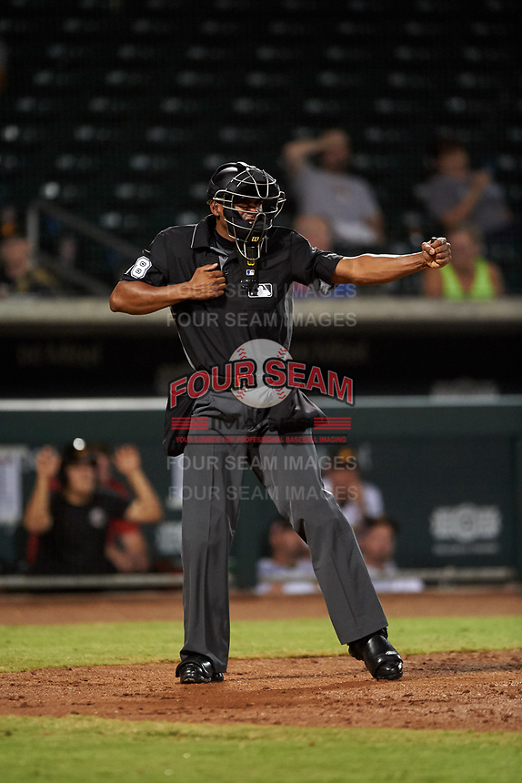 Home plate umpire Edwin Moscoso calls a batter out on strikes during an Arizona Fall League game between the Scottsdale Scorpions and Mesa Solar Sox on September 18, 2019 at Sloan Park in Mesa, Arizona. Scottsdale defeated Mesa 5-4. (Zachary Lucy/Four Seam Images)