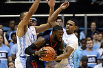 16 November 2014: Robert Morris's Lucky Jones (center) is guarded by North Carolina's Joel Berry II (right) and Brice Johnson (left). The University of North Carolina Tar Heels played the Robert Morris University Colonials in an NCAA Division I Men's basketball game at the Dean E. Smith Center in Chapel Hill, North Carolina. UNC won the game 103-59.