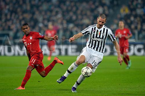 23.02.2016. Turin, Italy. UEFA Champions League football. Juventus versus Bayern Munich.  Leonardo Bonucci turns outside Douglas Costa and breaks upfield