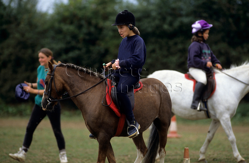 Horse riders in a riding school