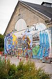 DENMARK, Copenhagen, Graffiti adorns a building near the Christiania district, Europe