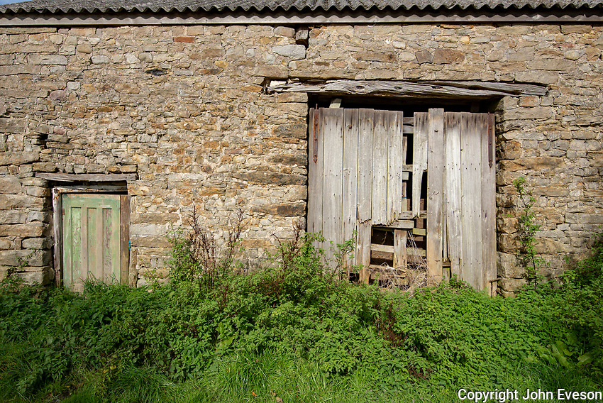 Wooden door on a stone barn, near Chipping, Preston, Lancashire.