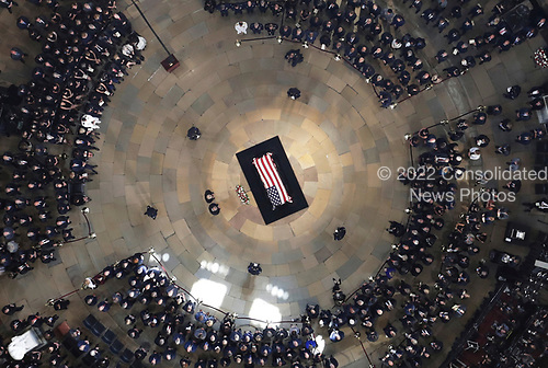 Senate leaders Mitch McConnell and Chuck Schumer stand near the casket as the late U.S. Sen. John McCain, R-Ariz., lies in state in the U.S. Capitol Rotunda Friday, Aug. 31, 2018, in Washington. (Pool photo by Morry Gash via AP)