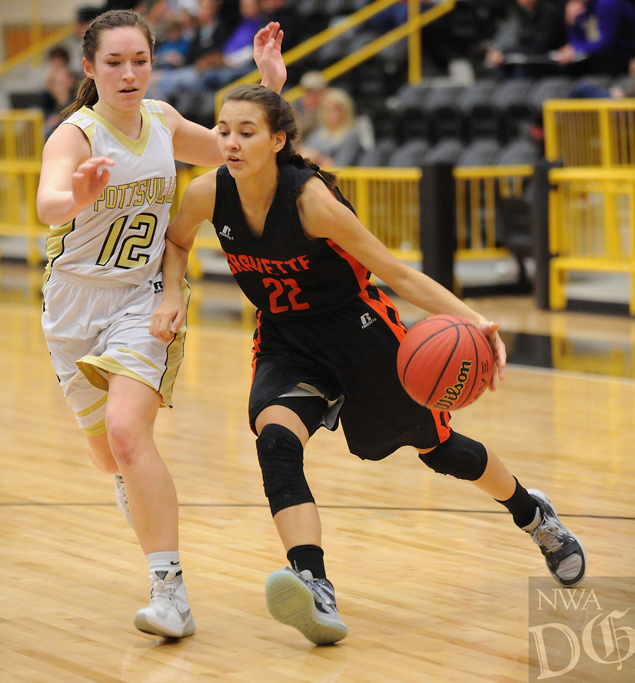 NWA Democrat-Gazette/ANDY SHUPE<br /> Tori Foster (22) of Gravette drives past Madi Rust of Pottsville Wednesday, Feb. 24, 2016, during the first half of play in the 4A North Regional Tournament in Tiger Arena in Prairie Grove. Visit nwadg.com/photos to see more photographs from the game.