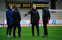 Blackpool's manager Terry McPhillips, third in from left, with his coaching staff prior to the game<br /> <br /> Photographer Chris Vaughan/CameraSport<br /> <br /> The EFL Sky Bet League One - Burton Albion v Blackpool - Saturday 16th March 2019 - Pirelli Stadium - Burton upon Trent<br /> <br /> World Copyright &copy; 2019 CameraSport. All rights reserved. 43 Linden Ave. Countesthorpe. Leicester. England. LE8 5PG - Tel: +44 (0) 116 277 4147 - admin@camerasport.com - www.camerasport.com