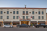 The historic Holland Hotel in Alpine Texas. The Holland Hotel was build in 1912 by Mr. John R. Holland a cattleman for travelors in the area.  Over the years the hotel has changed ownership many times and been renovated many times.  The latest owner is Greenwich Hospitality Group which restore it to it former glory in 2011  with 24 hotel rooms and added a fullscale restaurant the The Century Bar and Grill.  It was granted historic status in 1980.