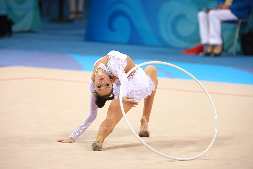 August 23, 2008; Beijing, China; Rhythmic gymnast Anna Bessonova of Ukraine reaches for hoop on way to winning bronze in the Individual All-Around final at 2008 Beijing Olympics..(©) Copyright 2008 Tom Theobald