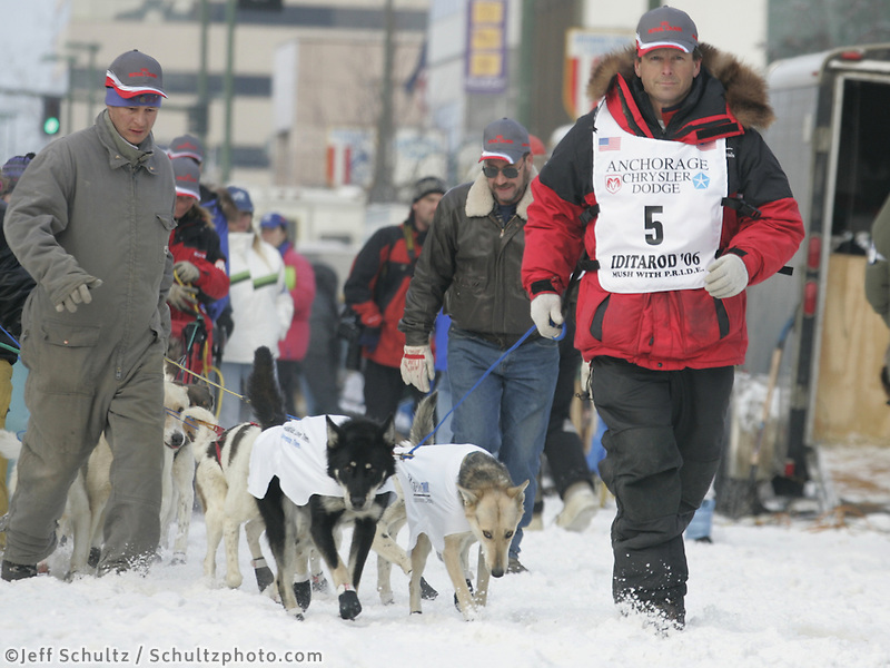 3-time winner Doug Swingley walks his dogs to the start line on Anchorage's 4th Avenue.