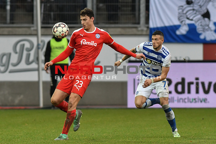 02.12.2018, Schauinsland-Reisen-Arena, Duisburg, GER, 2. FBL, MSV Duisburg vs. Holstein Kiel, DFL regulations prohibit any use of photographs as image sequences and/or quasi-video<br /> <br /> im Bild v. li. im Zweikampf Janni-Luca Serra (#23, Holstein Kiel) Andreas Wiegel (#7, MSV Duisburg) <br /> <br /> Foto &copy; nordphoto/Mauelshagen