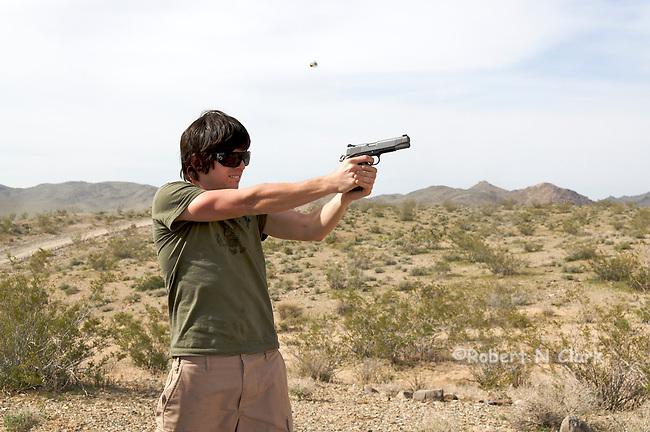 Youth firing Kimber .45 ACP semiauto pistol